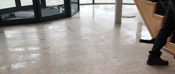 a dirty and stained marble floor